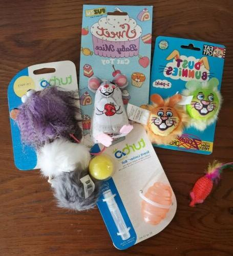 lot of cat toys dust bunnies scent